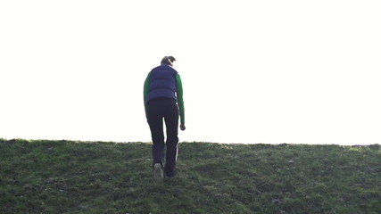 Woman running up the hill, super slow motion, shot at 240fps