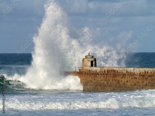 Portreath pier big white water sea wave splash, Cornwall UK.