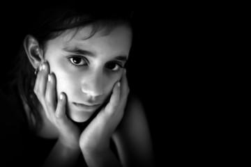 Sad hispanic girl in black and white