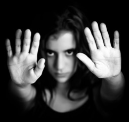 Girl with hands signaling to stop in black and white