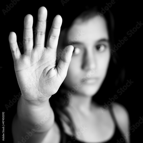 Girl with a hand signaling to stop in black and white