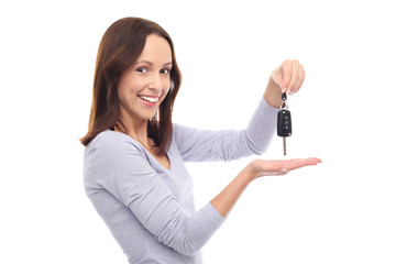 Young woman showing car key
