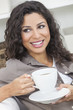 Happy Hispanic Woman Smiling Drinking Tea or Coffee