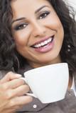 Happy Hispanic Woman Smiling Drinking Tea or Coffee