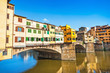 Ponte Vecchio with river Arno in Florence, Italy