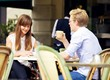 Young Couple Talking Over a Cup of Coffee
