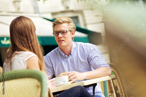 Handsome Blond in a Discussion with Girlfriend