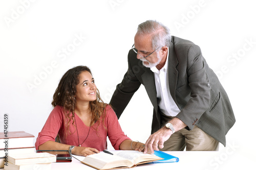 Teacher giving instructions to student