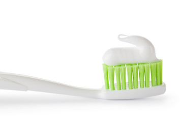 Toothpaste on the toothbrush. Closeup.