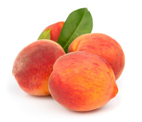 fresh peaches with leaves