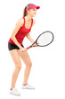 Full length portrait of female tennis player ready to play