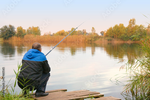 man fishing on the lake