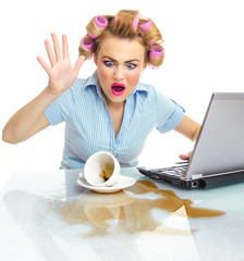 Angry business woman with chaos on workspace. Dirty desktop
