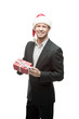 cheerful businessman in santa hat holding red gift