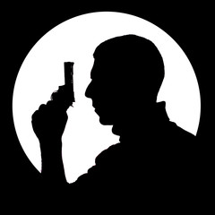 Silhouette of man with gun on the black background