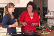 Two women in Kitchen are cooking