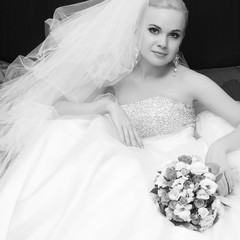 portrait of a beautiful blonde bride with great vapory veil and