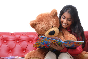 Charming girl reading book