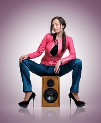 Fashionable young woman on the speaker
