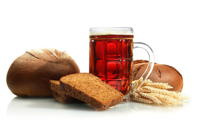 tankard of kvass and rye breads with ears, isolated on white