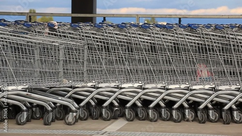 Line of many shopping baskets