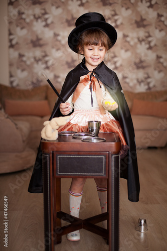 child posing in Attire conjurer with a magic wand