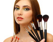 portrait of beautiful woman with make-up brushes, isolated