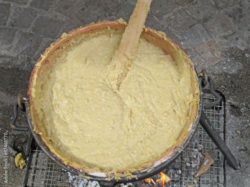 cauldron over the fire with cream corn called polenta