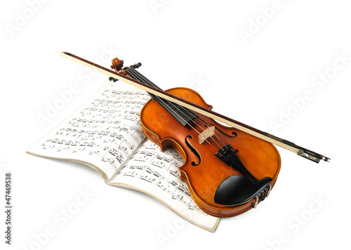 Violin and fiddle stick over score isolated on white - 47469538