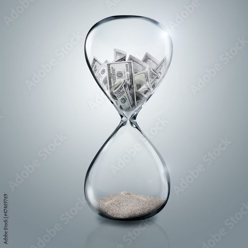 money in sand glass