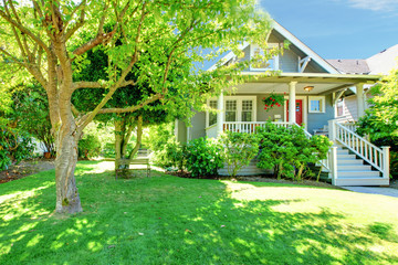 Grey old American house with summer landscape.