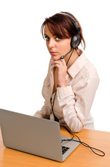Woman wearing a headset with a laptop