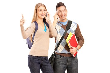 A happy students talking on a phone and giving thumb up