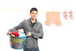 Smiling guy posing near a laundry line with clothes