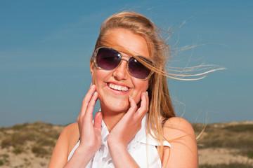 Pretty summer fashion girl on the beach with blue sky.