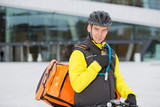 Cyclist With Courier Delivery Bag Using Walkie- Talkie