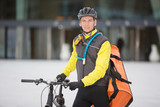 Young Male Cyclist With Courier Delivery Bag