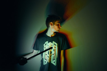 Concept shot of a young male holding stick