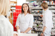 Female Pharmacist Helping Customer