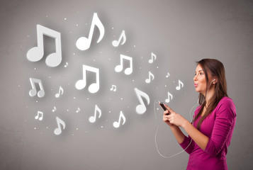 Pretty young woman singing and listening to music with musical n
