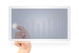 Hand pushing finance graph on tablet screen isolated.