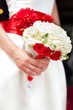 Bride holding bridal bouquet close up