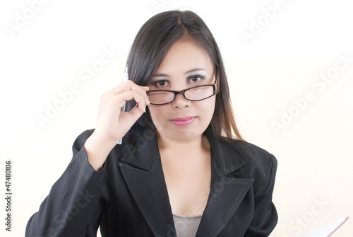 Business lady thinking with her work.