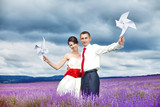happy young couple in a lavender field