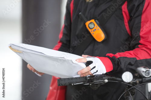 Female Cyclist Holding Courier Package