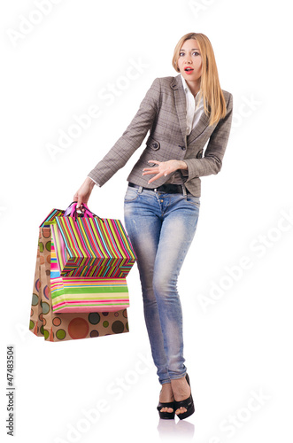 Attractive woman after christmas shopping on white