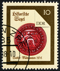 Postage stamp GDR 1988 Muhlhausen Saddler, Seal from 1565