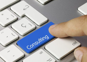 Consulting keyboard key. Finger