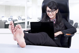 Beautiful businesswoman relaxing in office