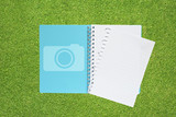 Book with Camera icon  on grass background